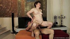 Hot mature lady with sexy tits gets her wild desires fulfilled on the sofa