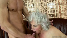 The mature lady enjoys a deep fucking from behind before he cums on her face