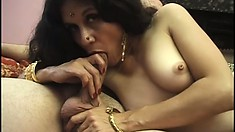 She gets fingered while eating cock and then shows fine ass and fucks