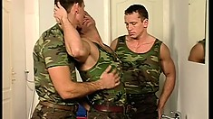 Hunky young soldiers whip their throbbing cocks out in a hot threesome