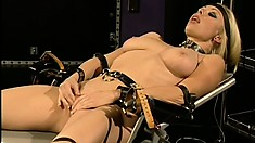 Hot lesbians in kinky bondage gear takes us into their dungeon