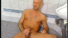 Oiled up studs work out by tugging on their massive hard members