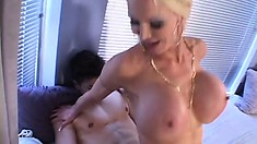 Horny blonde lady with huge boobs sucks and fucks a young stud's cock