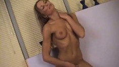 This sexy slut is so excited that she rubs one off on the spot
