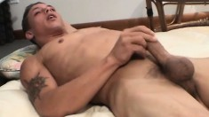 Hot young stud Christian strokes his long dick and cums on himself