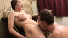 Short haired brunette with big boobs welcomes a stiff cock up her ass