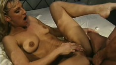 Sultry blonde harlot with a tattoo grinds a hot and thick penis