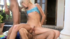 Sexy blonde gets two willing dudes to stick their cocks where she wants them