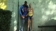 Dirty blonde offers a well hung biker an awesome handjob in the alley