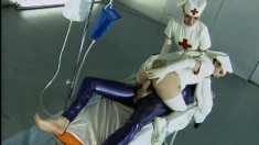 Two fetish nurses fucking with their patient clad in blue latex