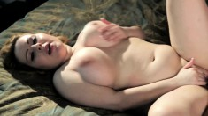 Curvy Lily gets naughty and takes a cock in between her juicy jugs