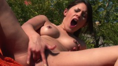 Frisky young Connie moans while stuffing her twat with a huge dildo