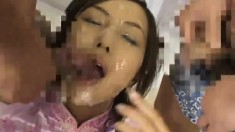 Lovely Asian lets these guys cum all over her while wearing a sexy outfit