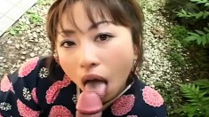 Asian cutie Mirai Hirooka gets lessons on how to suck a dick outside