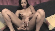 Sensual ebony babe Misty Stone gets naked and fingers her tight pussy
