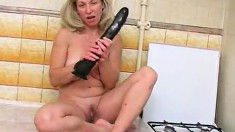 Naughty blonde housewife with big breasts has a passion for huge toys
