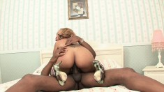 Busty Melrose Foxxx gets nailed by a big black and sucks in between