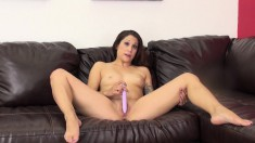 Horny little Katt Lowden spreads wide on the couch to show and toy it