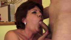 Kinky redhead mature wildly fucks a huge dildo and a young man's dick