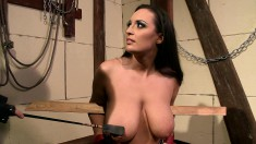 Very hot brunette is tortured and strung up and he makes her blow him