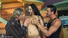 Big tit babe Carmella Bing has two cocks fucking her holes and gets a DP
