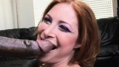 Busty redhead Ginger Blaze has a big black in her mouth, then her twat