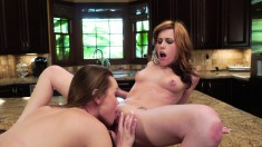 Monica Rise and Sasha Heart enjoying wild lesbian sex in the kitchen