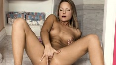 Splendid blonde uses her fingers and a glass dildo to reach her climax