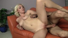 Sultry blonde slut sucks and fucks boyfriend's long cock on the couch