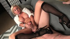 Busty blonde milf in black stockings loves to milk a young man's dick
