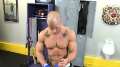 Bald ripped stud gets into a cage alone and plays with himself