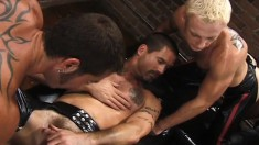 Lusty hunks engage in fellatio and ass fisting and fucking in an alley three-way