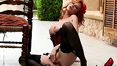 Tara White is a fiery hot redhead that will burn you with her sex appeal