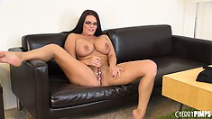 Mackenzee poses on the couch and spreads wide to finger her cunt