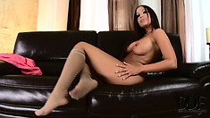 Tempting bitch in stockings is dandling her wonderful snatch