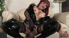 Stacked redhead mature lady in a sexy latex suit slowly fingers that guy's ass