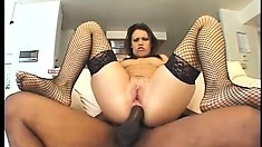 Sultry brunette with big boobs has a huge black cock stretching her sweet holes