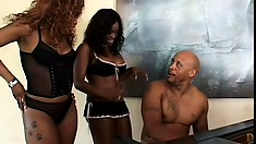 Attractive caramel babes take turns wildly bouncing on the black stud's huge cock