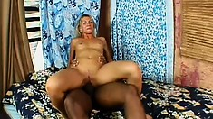 Blonde tart satisfies her urges with a monumental black piston