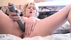 Petite blonde with a spicy ass Marcy drives a dildo in and out of her fiery peach