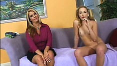 Buxom cougar and sexy slim teen get together on the couch and share a big dick