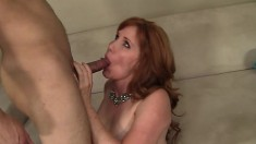 Lustful redhead milf Froya seduces and fucks a young stud on the couch