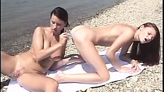 Two amazing college babes engaging in wild lesbian sex in the outdoors