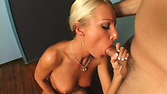 European beauty rubs her sweet pussy while giving an awesome blowjob
