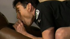 Gay interracial three way in the locker room with horny cop ass fuckers