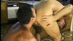 Skinny dude bends over to have his ass dominated by muscled hunk