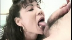 Big titted Asian MILF gets it on with a teacher in the classroom