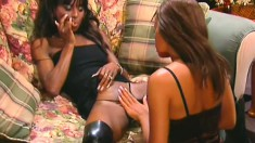 Two marvelous ebony babes please each other and share a big white cock