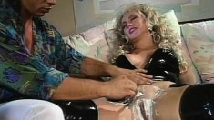 Busty blonde in black high-heeled boots gets spit roasted by two hung studs