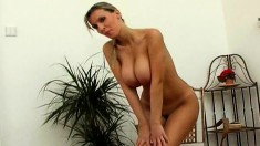 Attractive Milly Moris teases by rubbing oil on her big juicy tits